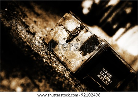 Grungy Tilted Picture From A Ground View Perspective On Small Arms Wooden Ammunition Box Sitting On A Gravel In A War Torn City During Conflict - stock photo