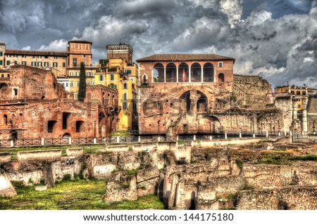 Grungy vintage picture of Trajan's Market buildings and archaeological site near Via dei Fori Imperiali in Rome - stock photo