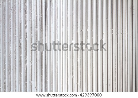 Grungy white and gray metal window roller blinds background - stock photo