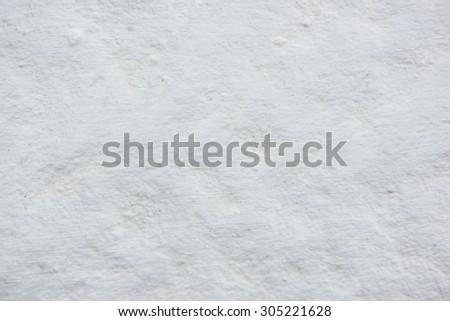 Grungy white concrete wall background. - stock photo