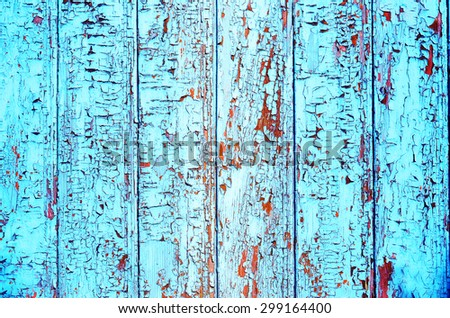 Grungy wood planks wall texture with blue peeling paint - stock photo