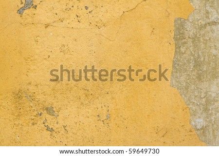 Grungy yellow stone wall artistic background - stock photo