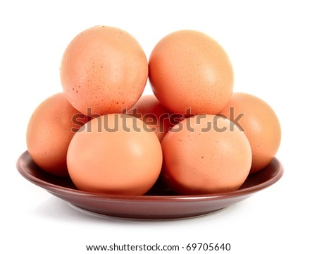 Grup of brown hen's eggs in the plate isolated on white