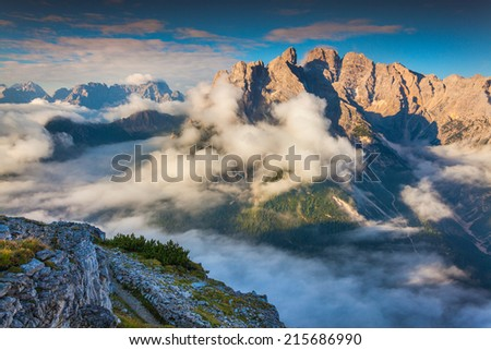 Gruppo Del Cristallo mountain range at foggy summer morning. Dolomites mountains, Italy, Europe. - stock photo
