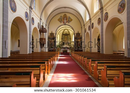 GRUYERES, SWITZERLAND - AUGUST 20, 2013: Interior of the church of Saint Theodul, consecrated in 1254 under Count Rodolphe III of Gruyere, on August 20, 2013 in Gruyeres, Switzerland.