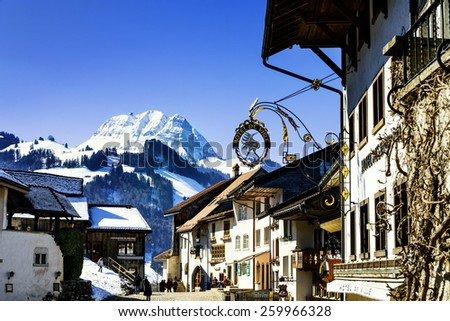 GRUYERES, SWITZERLAND - MARCH 03, 2015: View of the main street in the swiss village Gruyeres, Switzerland . The town and region are famous for their Swiss Cheese called Gruyere. - stock photo
