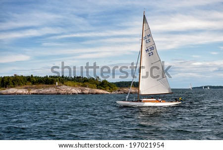GRYT, SWEDEN - JULY 22: Classic vintage M30 sailing boat cruises on July 22, 2009 in the archipelago of Gryt. This archipelago is a popular destination for sailing boats during summer.