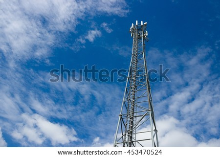 GSM (4G) antenna tower (transmitter, antenna), blue sky with white clouds. - stock photo