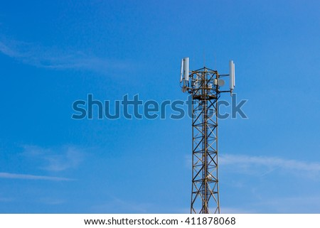 GSM tower (antenna). Blue sky, white clouds. - stock photo