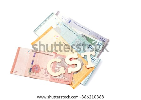 GST or Goods and Services Tax alphabet letters with Malaysian currency and white Background . Concept of Government Service Tax.