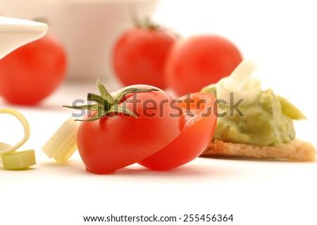 Guacamole on whole grain rusk and tomato - stock photo