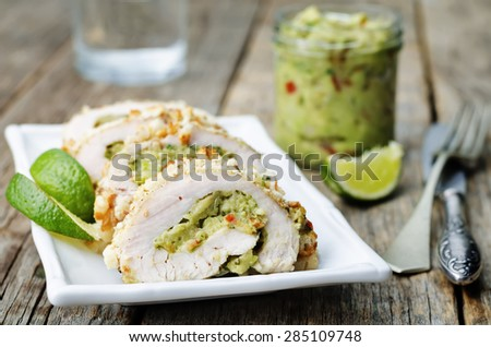 guacamole stuffed crumbs lime chicken. the toning. selective focus crumbs - stock photo