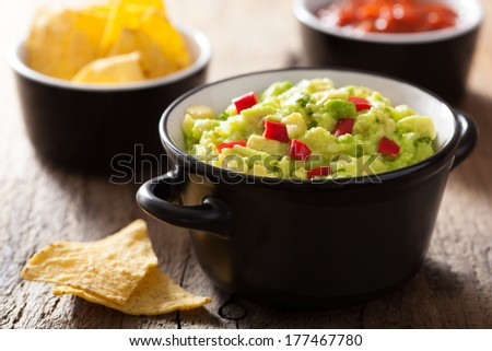 guacamole with avocado, lime, chili and tortilla chips - stock photo