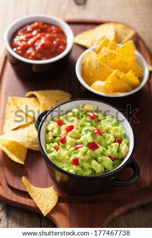 guacamole with avocado, lime, chili and tortilla chips, salsa