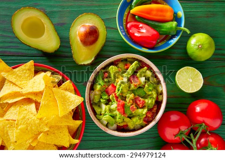 Guacamole with avocado tomatoes and nachos mexican food - stock photo