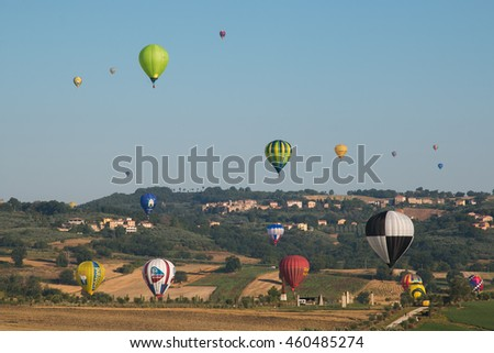 GUALDO CATTANEO, ITALY - JULY 29, 2016: Sagrantino International Challenge Cup. Multicolored hot air balloons flying over umbria villages.
