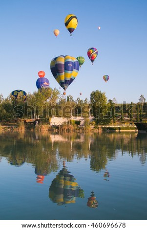 GUALDO CATTANEO, ITALY - JULY 29, 2016: Sagrantino International Challenge Cup. Summer landscape with lake and hot air balloons.