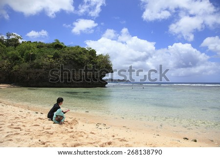 Guam Beach kids - stock photo