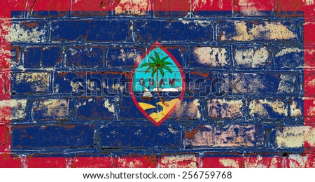 Guam flag painted on old brick wall texture background - stock photo