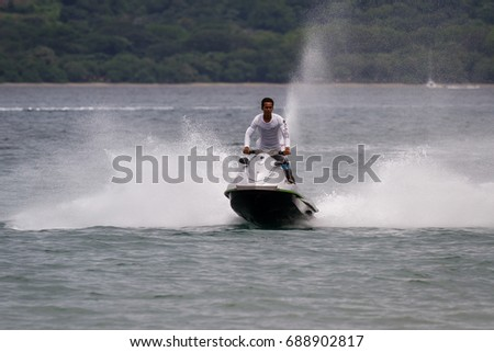 Guanacaste, Costa Rica- July 25: riding wave runners in Nacascolo Beach. July 25 2017, Guanacaste, Costa Rica.
