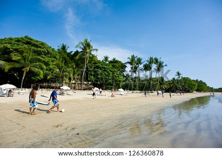 GUANACASTE, COSTA RICA - MAY 25: Playa Tamarindo on May 25, 2012 in Costa Rica. Tamarindo is a beach town located on the Northwest Pacific coast of Costa Rica in the Province of Guanacaste. - stock photo