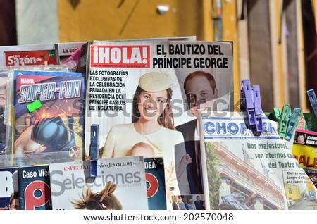 GUANAJUATO, MEXICO - NOVEMBER 9, 2013: World Heritage Site (1988). Magazines sold at street market in the Historic mine city of Guanajuato. - stock photo