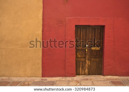 GUANAJUATO, MEXICO - September 24, 2015: Street view of wall and doors in colonial San Miguel de Allende, the UNESCO World Heritage Site. 16th century old buildings & streets are preserved.