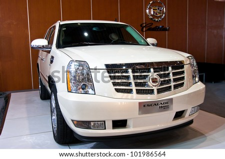 GUANGZHOU, CHINA - APR 28: CADILLAC Escalade white car on display at the 2012 Guangzhou daily BaiYun INT'L Auto-expo,on April 28, 2012 in Guangzhou China,This is a large international car exhibition - stock photo