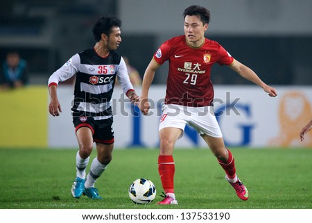 GUANGZHOU,CHINA-APRIL 03:Gao Lin #29 of Guangzhou Evergrande for the ball during the AFC Champions League between Guangzhou Evergrande and Muangthong Utd.at Tianhe Stadium on April 3, 2013in,China.