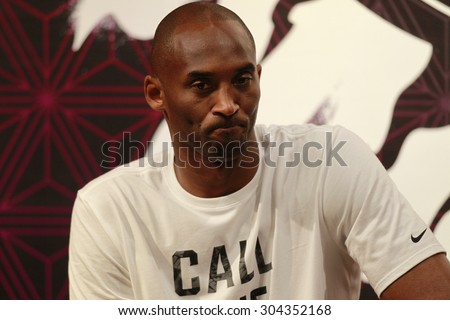 GUANGZHOU, CHINA - AUG 2. 2015:NBA basketball player Bryant Kobe of Los Angeles Lakers seats during a promotional event at a store in Guangzhou. - stock photo