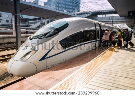 Guangzhou,China - DEC 12:High-speed trains on Dec 12, 2014 in Guangzhou. The average speed of 250 km. - stock photo
