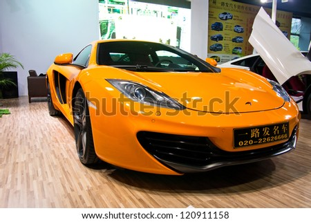 GUANGZHOU, CHINA - DEC 1:Mclaren MP4-12C orange car on display at the 10th China(Guangzhou) International Automobile Exhibition. on Dec 1, 2012 in Guangzhou China. - stock photo