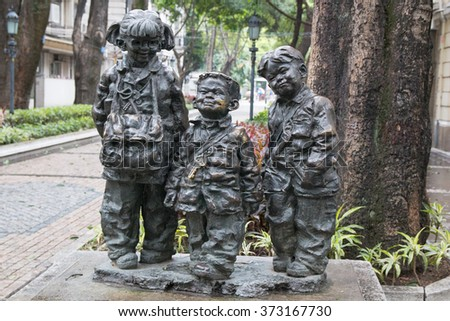 Guangzhou, China - January 25, 2016: Metallic bronze statue at Shamian Island. Shamian Island old colonial architectures in Chinese city Guangzhou.