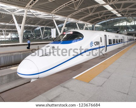 GUANGZHOU, CHINA - JULY 8: Modern train waits at platform on July 8, 2010 in Guangzhou station, Guangzhou, China. China invests in fast and modern railway, trains with speed over 340 km/h.
