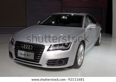 GUANGZHOU, CHINA - NOV 26: Audi A7 car on display at the 9th China international automobile exhibition on November 26, 2011 in Guangzhou China. - stock photo