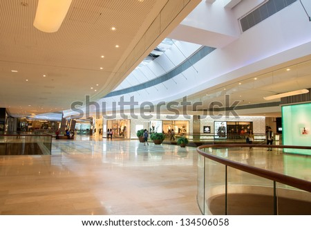 GUANGZHOU, CHINA  - NOV 20: TaiKoo Hui is a major International level luxurious shopping centre on Nov 20, 2011 in Guangzhou. Designed by world-renowned architectural firm Arquitectonica. - stock photo