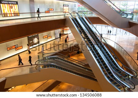 GUANGZHOU, CHINA  - NOV 20: TaiKoo Hui is a major International level luxurious shopping centre on Nov 20, 2011 in Guangzhou. Designed by world-renowned architectural firm Arquitectonica.