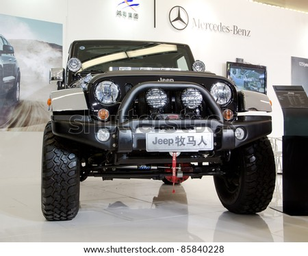 GUANGZHOU, CHINA - OCT 02: Jeep car on display at the Guangzhou daily Baiyun international automobile exhibition. on October 02, 2011 in Guangzhou China.