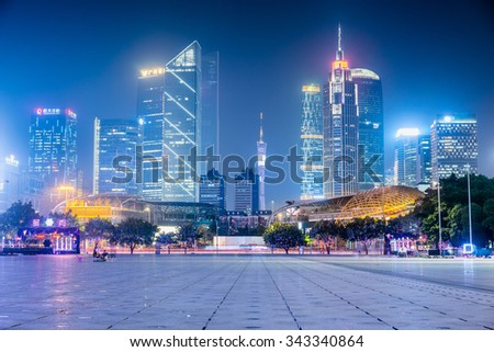 GUANGZHOU, CHINA - Sept. 28: Night view of modern buildings in Guangzhou. Many shopping malls and headquarters of big companies locate in Tianhe District, Guangzhou. - stock photo