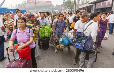 GUANGZHOU, GUANGDONG PROVINCE, CHINA - OCTOBER 12, 2006: People at train station in city of Guangzhou.