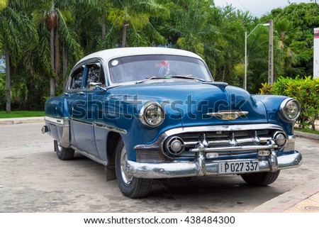 Guantanamo, Cuba - June 6, 2014: Old Chevrolet perfectly restored, parked in Guantanamo city.