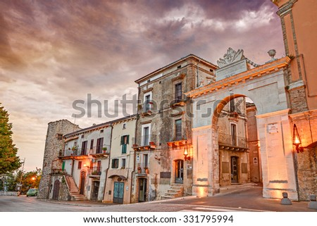 "GUARDIAGRELE, ITALY - SEPTEMBER 13: the old city door ""Porta di San Giovanni"" at sunset in the medieval italian town Guardiagrele, Abruzzo, Italy. Photo taken on September 13,2015"