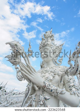 guardian angel at Wat Rong Khun temple in Chiang-Rai, Thailand - stock photo