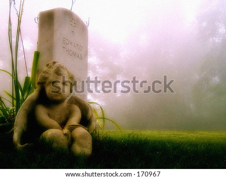 Guardian Angel on Grave - stock photo