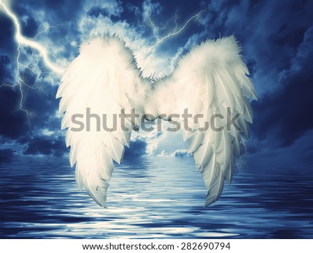 Guardian Angel white wings over dramatic sky. Religion and spiritual concept - stock photo
