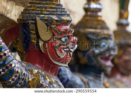 Guardian Demons at the Emerald Buddha Temple in Bangkok - stock photo