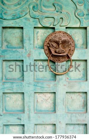 Guardian door detail in Hanoi, Vietnam - stock photo