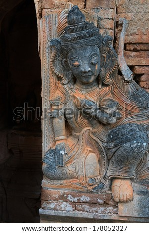 Guardian on ruins of ancient Burmese Buddhist pagoda Nyaung Ohak in the village of Indein on Inlay Lake in Shan State, Myanmar (Burma).