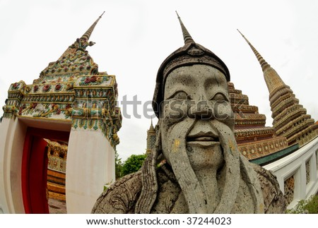 Guardian statue (yak) at the temple Wat pho, one of the major tourist attractions in Bangkok, Thailand