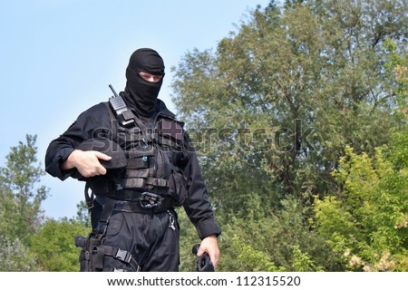guarding VIPs, special forces policeman - stock photo